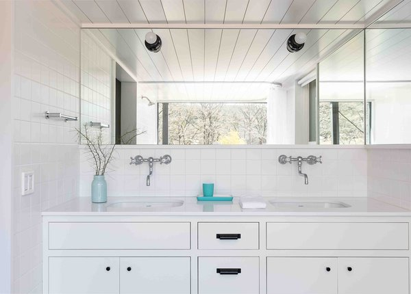 A mirror directly across from the en suite's massive window serves to double the view.