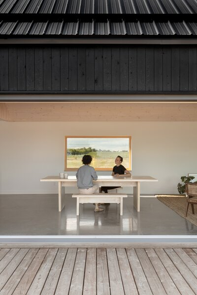 The large sliding doors in the common area open to the courtyard to bring the outside in.