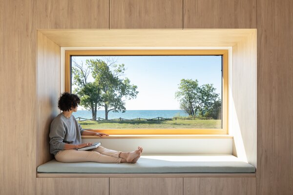 "The parents' bedroom is intentionally small, with a custom storage unit framing a giant window. ""It makes the views feel that much bigger,"" says Handa."