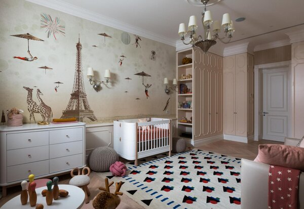 A whimsical bedroom from Bolshakova Interiors features an inviting rug, Moroccan pouf, and tiny stools that all offer opportunity for kids to read in whatever place or position they see fit.