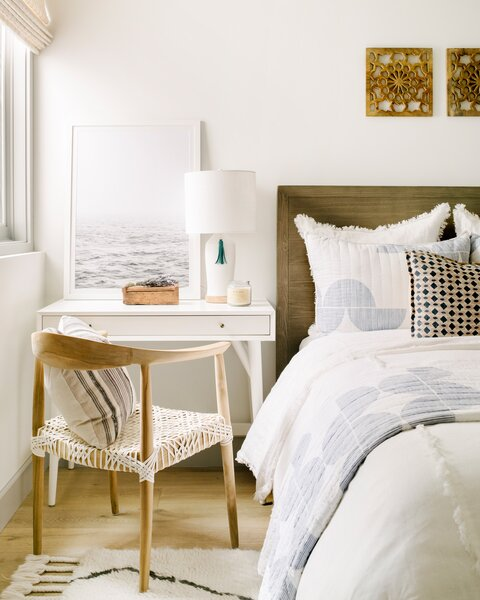 In a pinch, a desk can replace a bedside table, as demonstrated in this bedroom by designer Kate Lester.