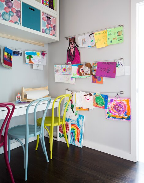 A closet is transformed by Pulp Design into a shared art studio for three sisters.
