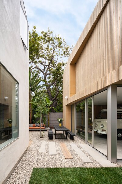 """The main house is a white stucco block—really, it couldn't be more different from this modernist box. """"Well, they both have flat roofs,"""" laughs Zünkeler."""