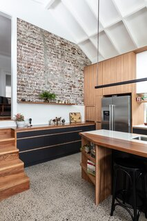 """Exposed brick from the original structure remains as an """"echo of the house that was here before,"""" says Szczerbicki."""