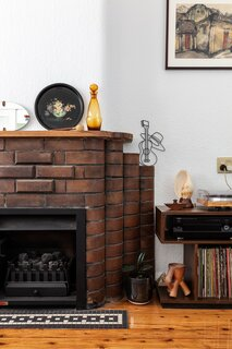 The mantle atop of the fireplace (an original feature of the home that survived the renovation) is the perfect display spot for Rose and Ben's latest finds.