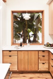 """Banana leaves grow right outside the window over the prep sink. """"It's the most beautiful painting in our house,"""" says Andrew."""