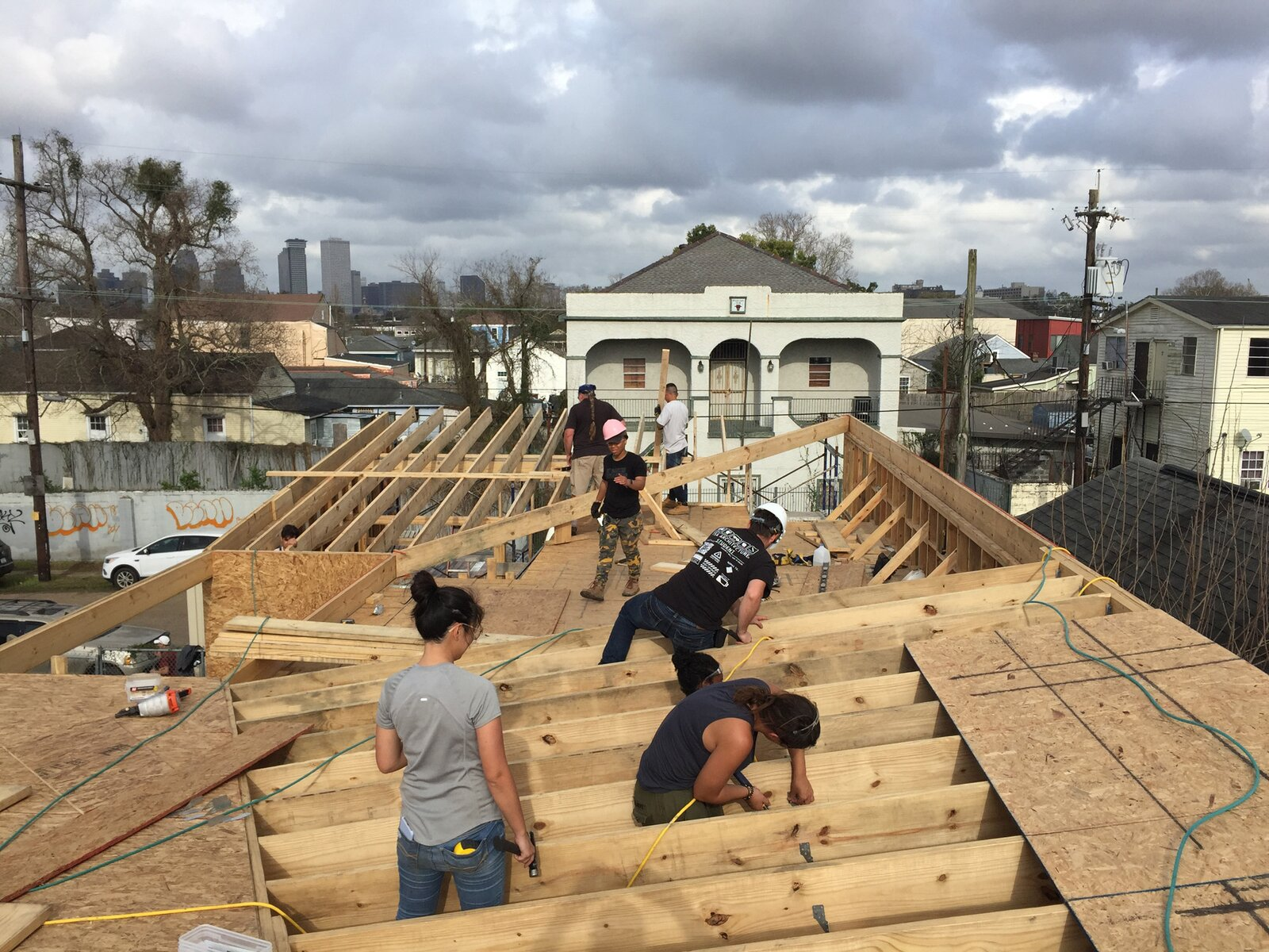 The students of UrbanBuild's class of 2020 get hands on designing the roof of UB15. This roof form, when completed, will bring water to the courtyard of the home.  Photo 7 of 7 in How Can Higher Education Build a Better Architect?