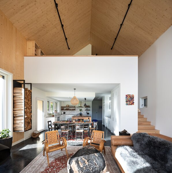 """Against the modernist backdrop of concrete, glass, and wood, antiques and family heirlooms create an inviting, homey atmosphere. """"It's an eclectic collection, but it all works together. Everything's so authentic. It's all Lexi,"""" says principal David Arnott."""