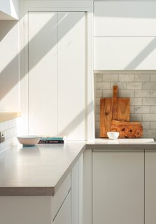 Though the homeowners liked the look of concrete countertops, they were honest with themselves that the upkeep wouldn't be a good fit for their lifestyle. So, Loader tracked down an experimental micro-cement, a waterproof plaster common in restaurant applications: It's got the industrial look Pete and Daisy love, but doesn't require sealing and maintenance.