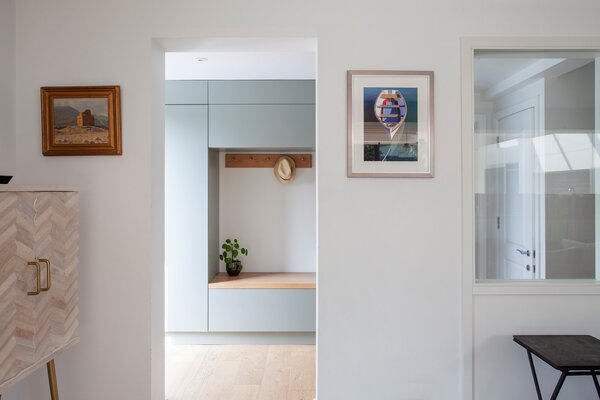 """Built-in cabinetry at the entryway ensures a place for everything is baked right into the design from the start. """"We try to encourage our clients on all projects to not make the house bigger than it needs to be,"""" says Loader. """"Make it the right size, and design a space for everything."""""""