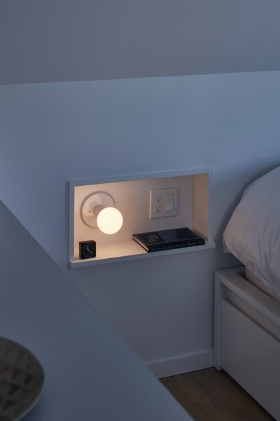 A small recess is built into the wall, acting as a side table.
