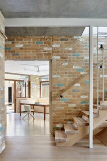 """The project's signature material was discovered on a trip to a recycled brick yard, where Welsch and the homeowners found light, cream-colored bricks and fell in love. """"It was a decision made on the spot,"""" explains Welsch. The original plan was to find darker materials that would make the home feel more cozy and cave-like, but the way these bricks reflected the sunlight was just irresistible. """"You don't necessarily expect that soft light feeling from a material like brick."""""""