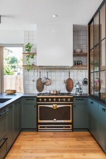 The six-burner La Cornue stove provided visual inspiration for the eclectic, vintage finishes throughout the rest of the home.