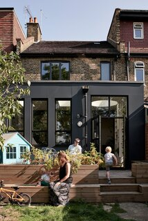 The architects embraced the modernist form of the new structure instead of cladding the extension in expensive brick to match the original Victorian's exterior.