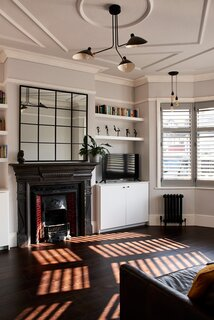 Black decorative details are incorporated into various living spaces throughout the house.