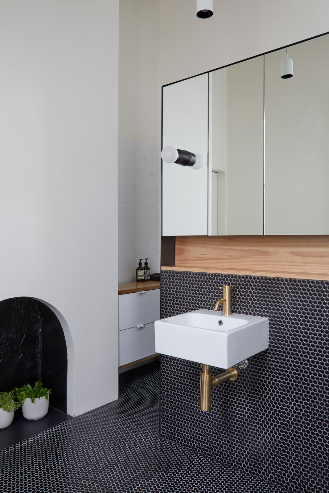 Bath Room, Pendant Lighting, Accent Lighting, Subway Tile Wall, Wall Lighting, Wood Counter, Ceramic Tile Floor, Wall Mount Sink, and Mosaic Tile Wall Ensuite vanity wall   Photo 12 of 21 in Thanks to a Double-Height Dining Room, a Melbourne Home Basks in Sunshine and Courtyard Views from South Yarra Void House