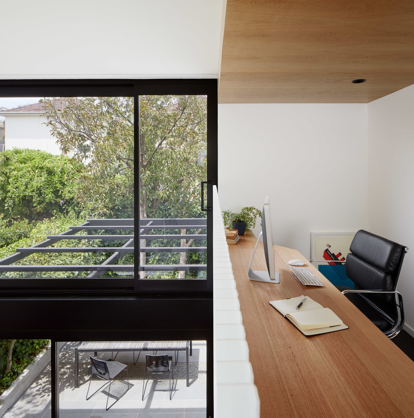 Office, Study Room Type, Chair, Carpet Floor, and Desk Study space overlooking void above dining space  Photo 10 of 21 in Thanks to a Double-Height Dining Room, a Melbourne Home Basks in Sunshine and Courtyard Views from South Yarra Void House