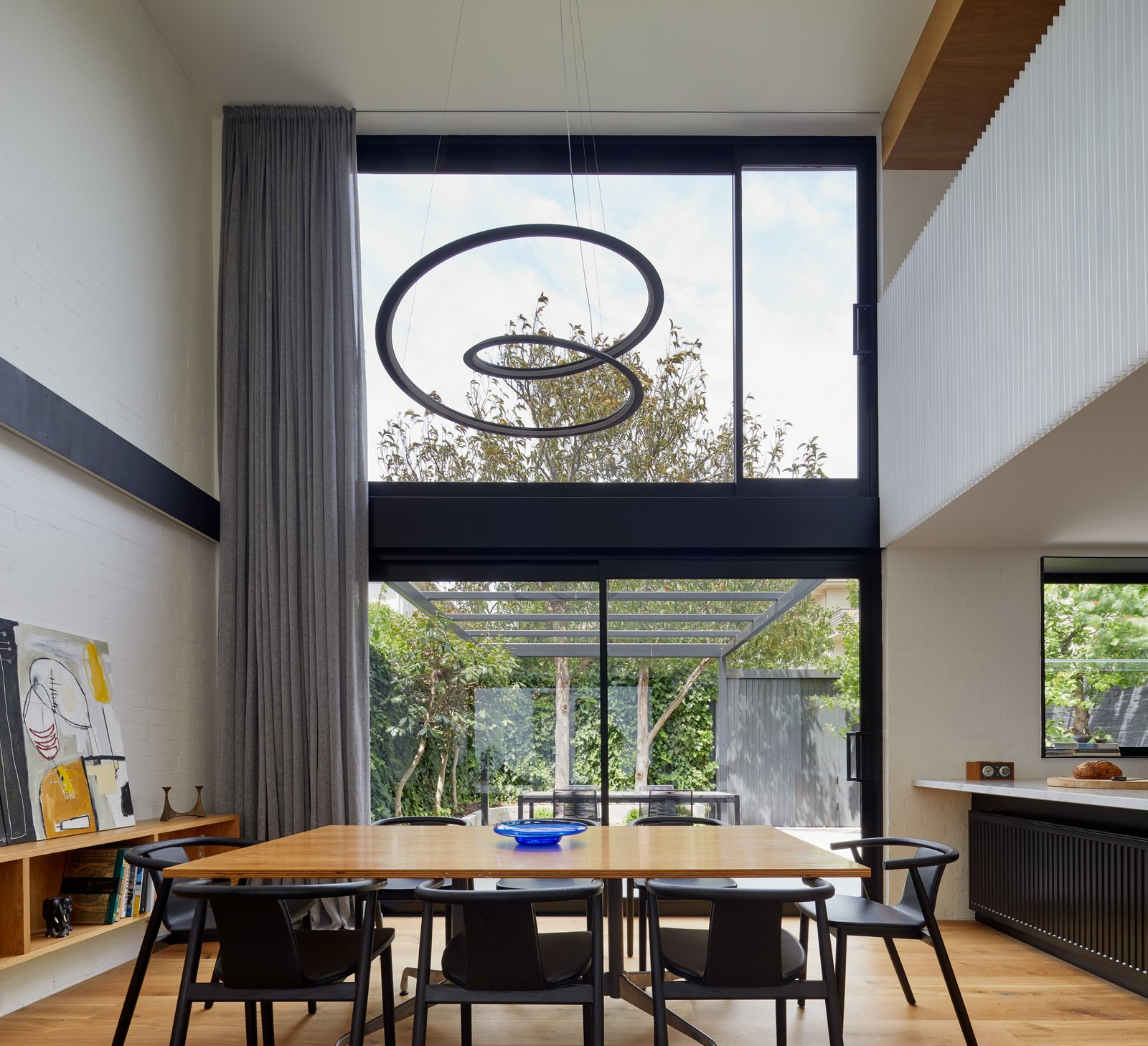 Dining Room, Accent Lighting, Recessed Lighting, Chair, Table, Light Hardwood Floor, and Pendant Lighting Void above Dining space  South Yarra Void House