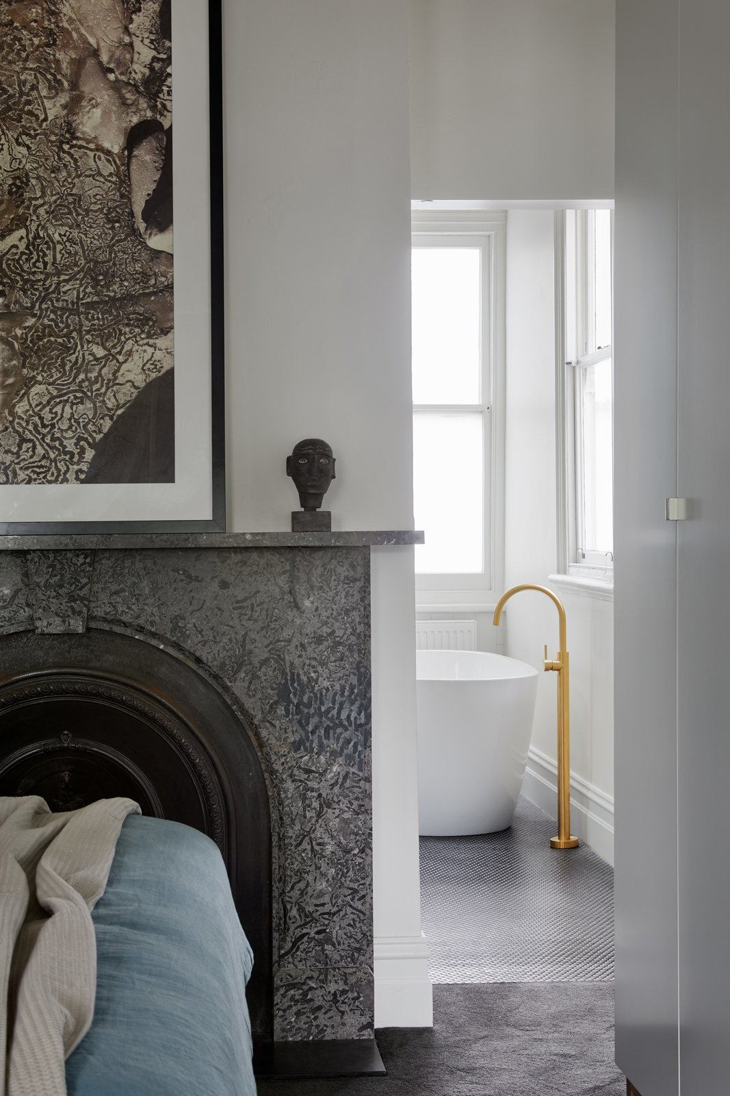 Bath Room, Freestanding Tub, Ceramic Tile Floor, and Subway Tile Wall Ensuite entry  Photo 14 of 21 in Thanks to a Double-Height Dining Room, a Melbourne Home Basks in Sunshine and Courtyard Views from South Yarra Void House