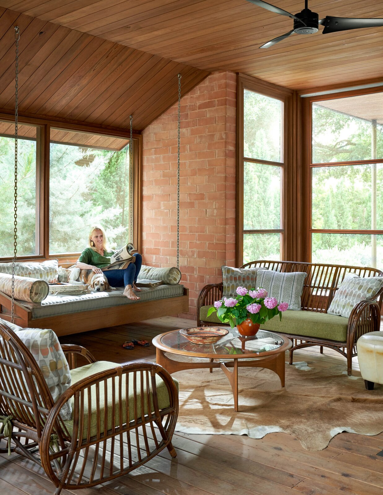 Screened-in porch at the River House 2 by Bentley Tibbs Architect