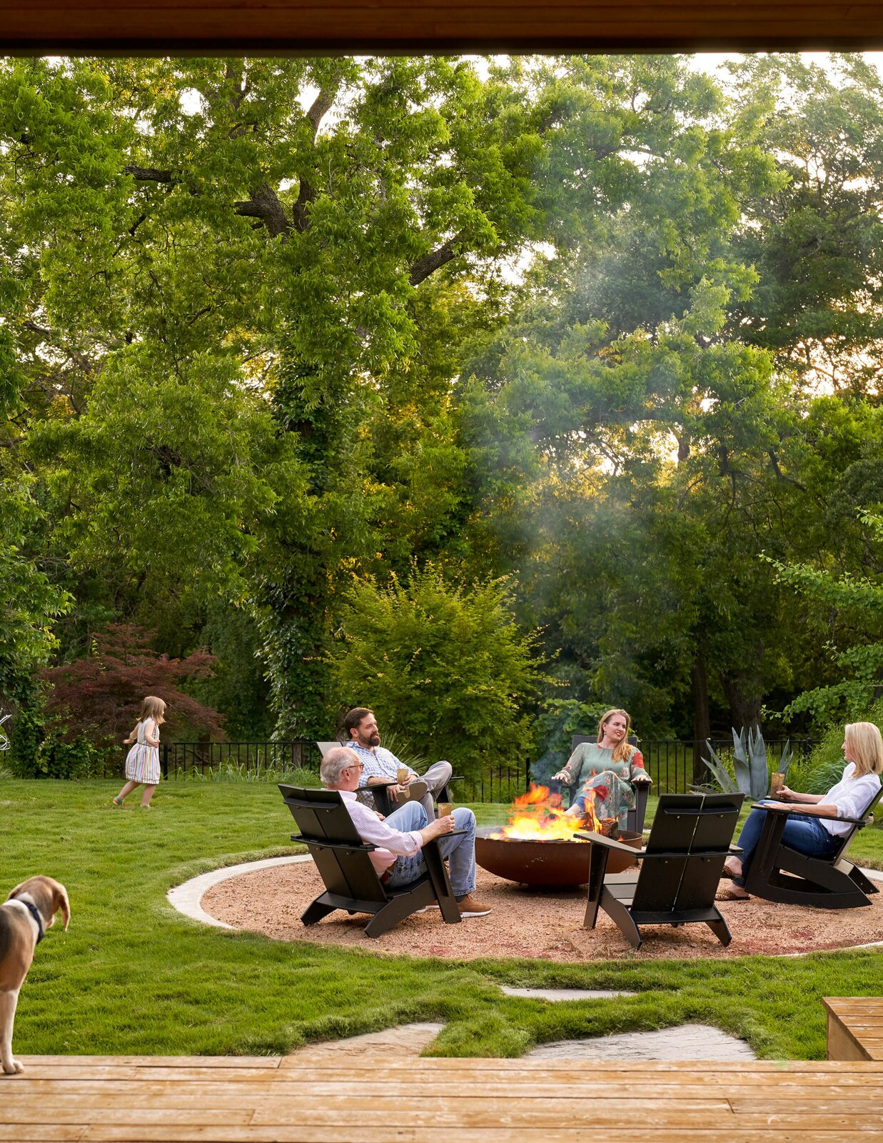 Backyard fire pit at River House 2 by Bentley Tibbs Architect