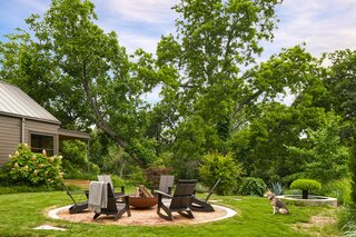 The backyard fire pit is handmade by Fire Pits of Atlanta with chairs by Room & Board.