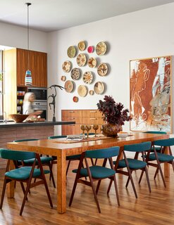 The Bogarts' kitchen boasts a painting by Otis Husband, an artist and art professor from Houston. The cabinets are walnut with an oiled finish.