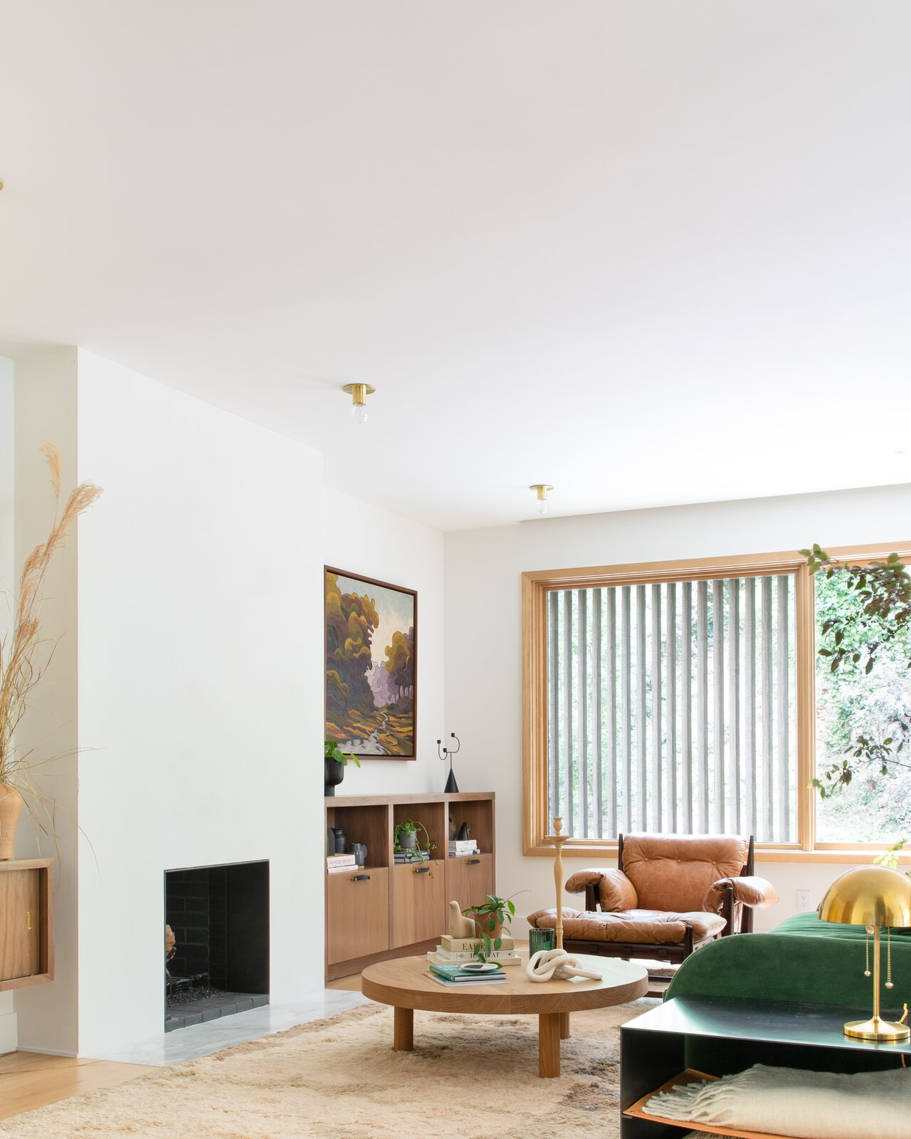 Living Room, Chair, Coffee Tables, Ceiling Lighting, and Standard Layout Fireplace Baker modernized the pre-existing fireplace by encasing it in sheetrock and bringing it forward into the room for modern, minimal feel.  Photo 1 of 14 in This Colorful House in San Francisco May Be Boxy, but It's Anything but Square
