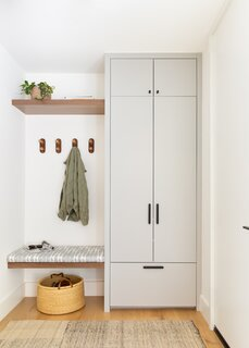 The entry boasts built-in cabinetry to the right of the front door and 4 wall hooks—one for each family member to hang everything from jackets to backpacks.