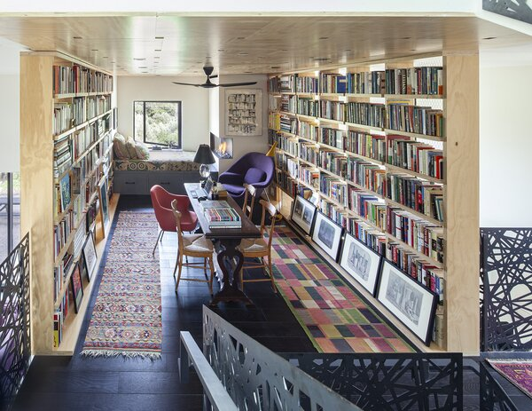 "The library, or ""basket of books,"" feels like a warm cocoon. The prints along the bottom shelf are by Giorgio Morandi."