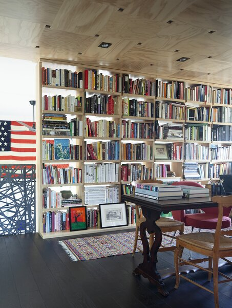 Another view of the library, with its Douglas fir ceiling and an 1872 family heirloom flag hanging in the background.