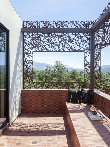 """The """"moon viewing"""" mirador porch sits off of the main bedroom and bathroom, framing the verdant countryside."""