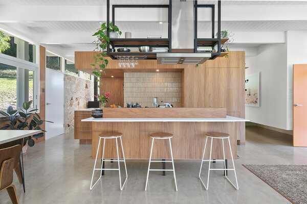 The wood-paneled kitchen features tiles made from Japanese finger mosaics.