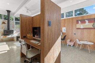 A private desk nook stands in the middle of the living area.