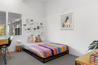 Ivy's bedroom is a source of joy, with its collaged art wall and colorful bedding.