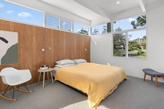 The sunny master bedroom encapsulates the couple's minimalist, midcentury aesthetic.