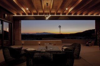 The outdoor living room connects the private and public wings of the house and offers spectacular sunset views.