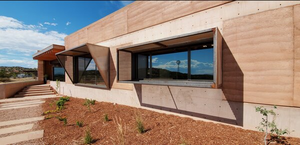 The custom steel sunshades are both sculptural and functional, offering respite from the hot desert sun.