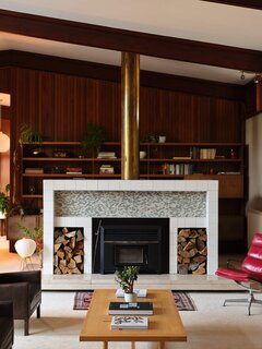 Another look at the fireplace with its brass chimney cover and floating marble hearth.