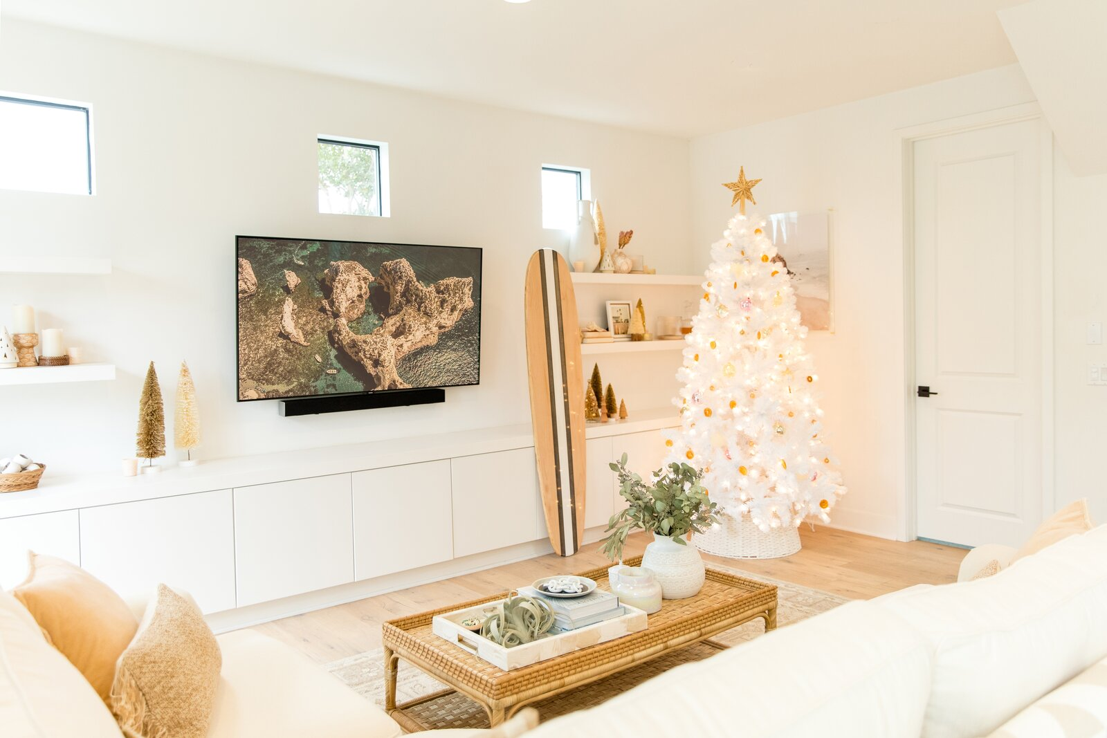 Living Room, Coffee Tables, Light Hardwood Floor, Storage, Sectional, and Shelves Living room set for a beachy Christmas  Photo 1 of 22 in Dwell's Holiday Gift Guides Are a One-Stop Shop for Everyone on Your Nice List