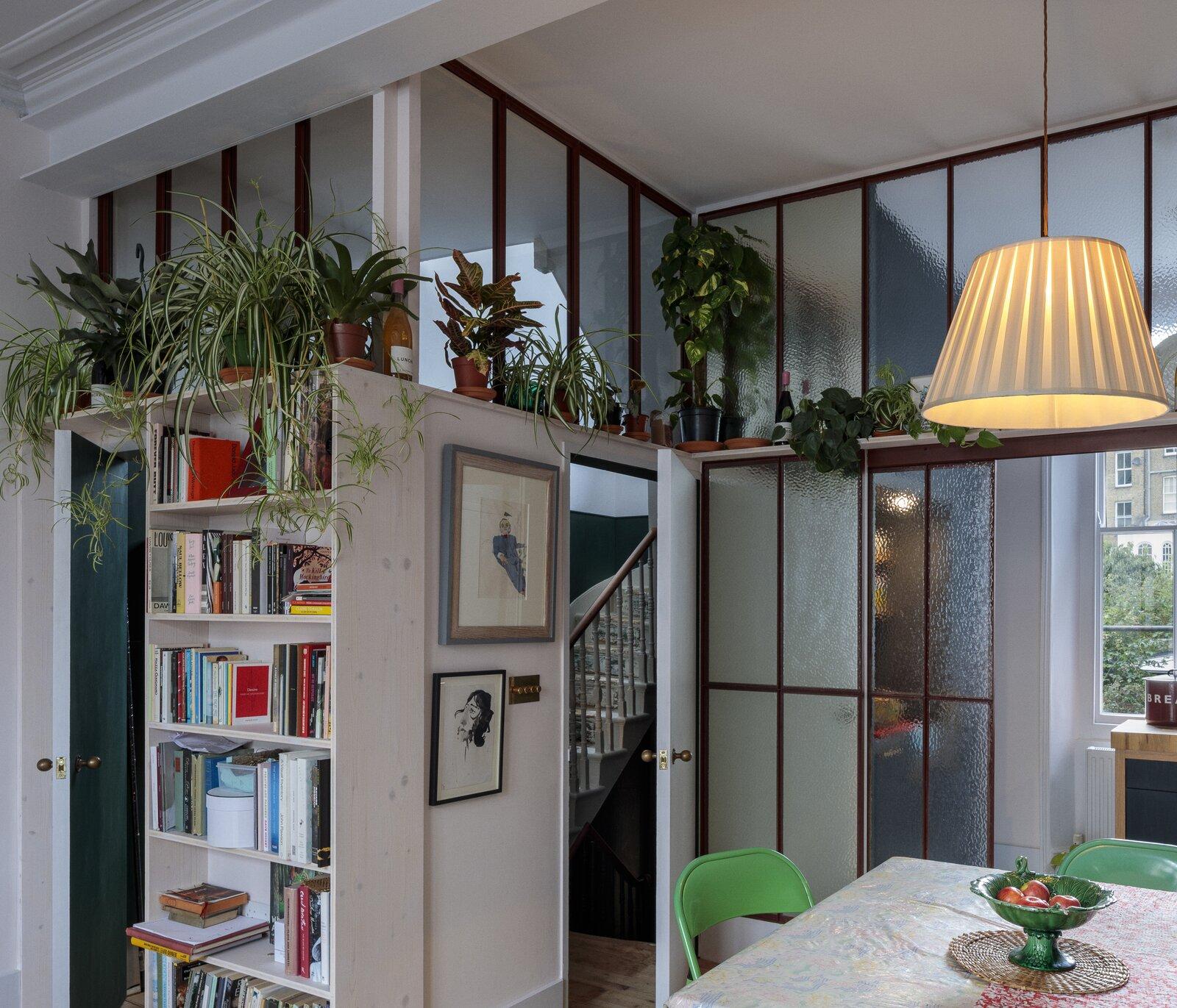 Living Room, Table, Medium Hardwood Floor, Chair, Shelves, Bookcase, and Ceiling Lighting Living space  Primrose Hill