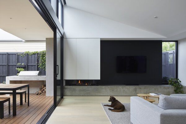 Living Room with Fireplace, Raked Ceilings & Concrete Rendered Credenza