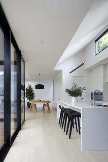 Kitchen & Dining Room with Raked Ceilings & High Window