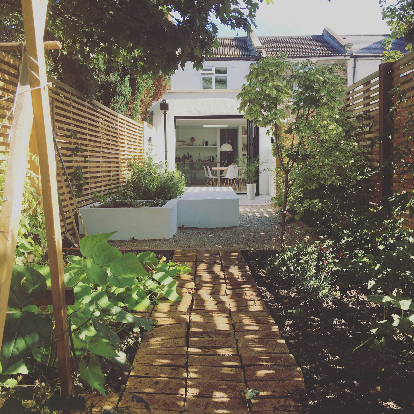 Outdoor, Wood, Garden, Vegetables, Raised Planters, Flowers, Shrubs, Trees, Landscape, Hardscapes, and Wood Garden with mature landscaping growing fruit, vegetables and flowers   Outdoor Vegetables Landscape Wood Photos from Studio Cottage