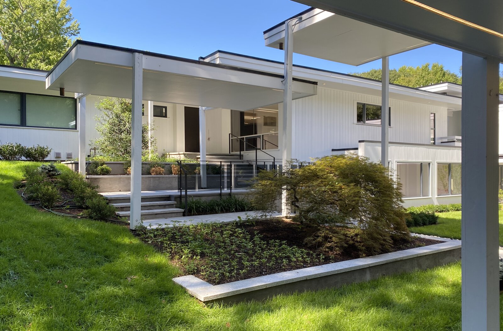Modern home with Exterior, Wood Siding Material, Flat RoofLine, and House Building Type. Entrance and canopies Photo 3 of A Gut Renovated MidCentury Modern Green Energy Home for Luxury Winter Living for $4.65m