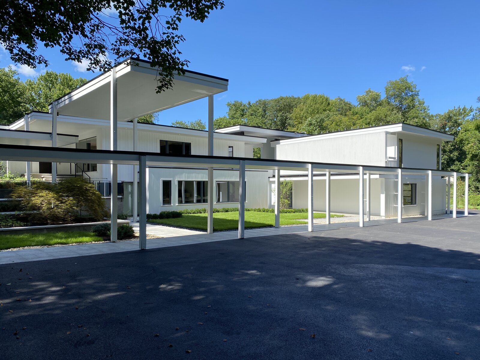 Modern home with Exterior, House Building Type, Wood Siding Material, and Flat RoofLine. Paul Rudolph designed canopies Photo 4 of A Gut Renovated MidCentury Modern Green Energy Home for Luxury Winter Living for $4.65m