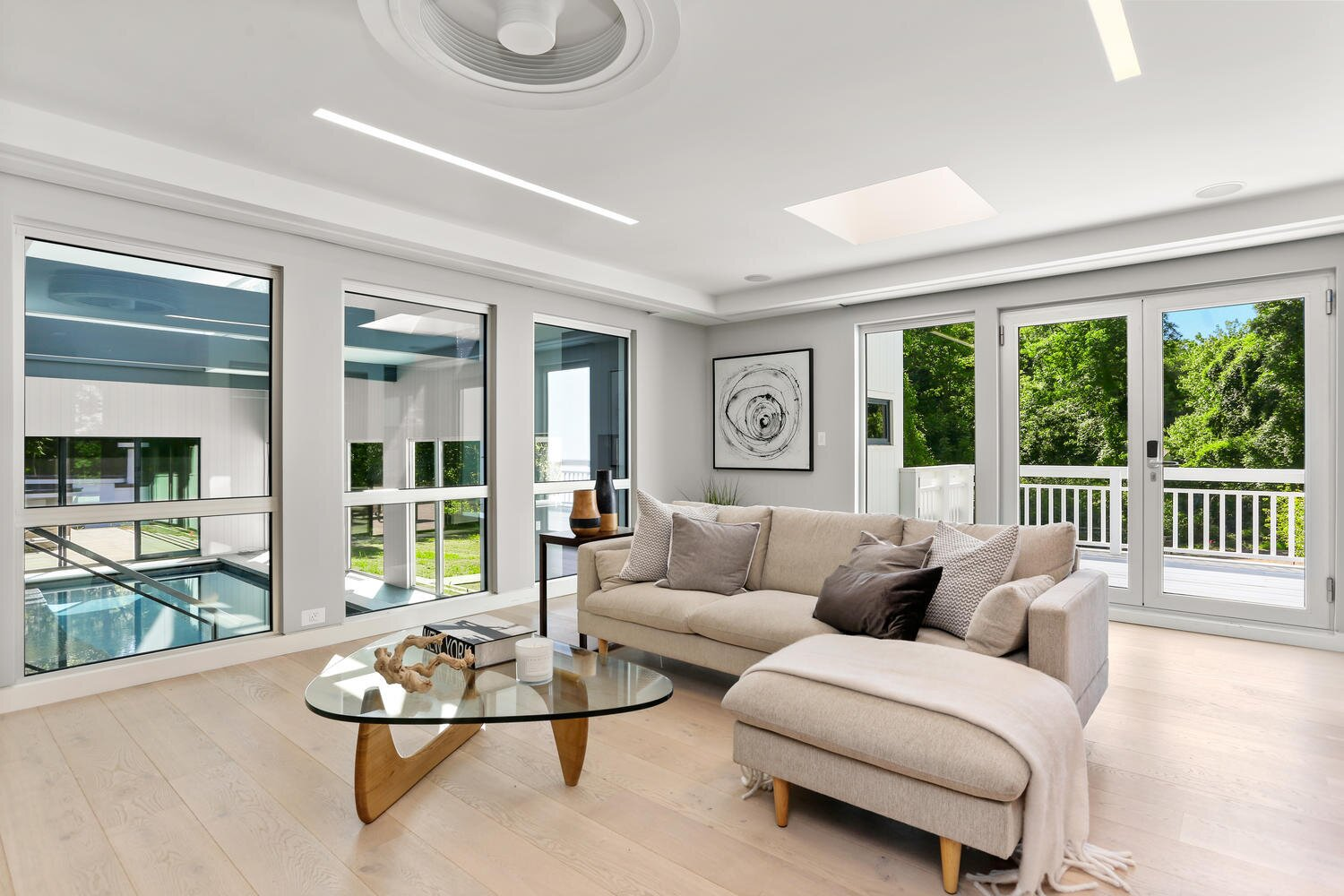 Modern home with Living Room and Ceiling Lighting. Sunroom overlooking Indoor Pool Photo 14 of A Gut Renovated MidCentury Modern Green Energy Home for Luxury Winter Living for $4.65m