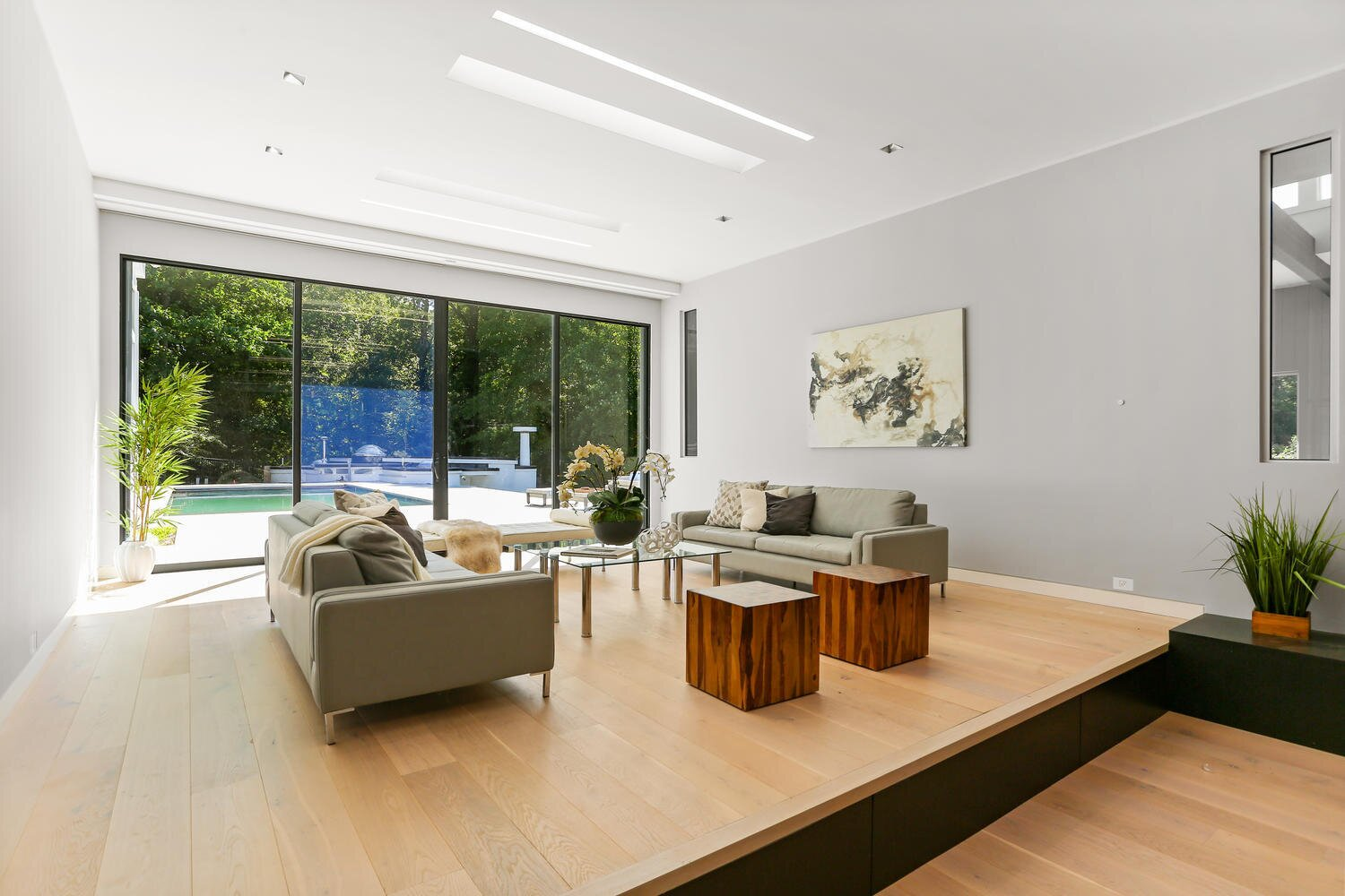 Modern home with Living Room, Ceiling Lighting, Two-Sided Fireplace, and Gas Burning Fireplace. Living room  Photo 10 of A Gut Renovated MidCentury Modern Green Energy Home for Luxury Winter Living for $4.65m
