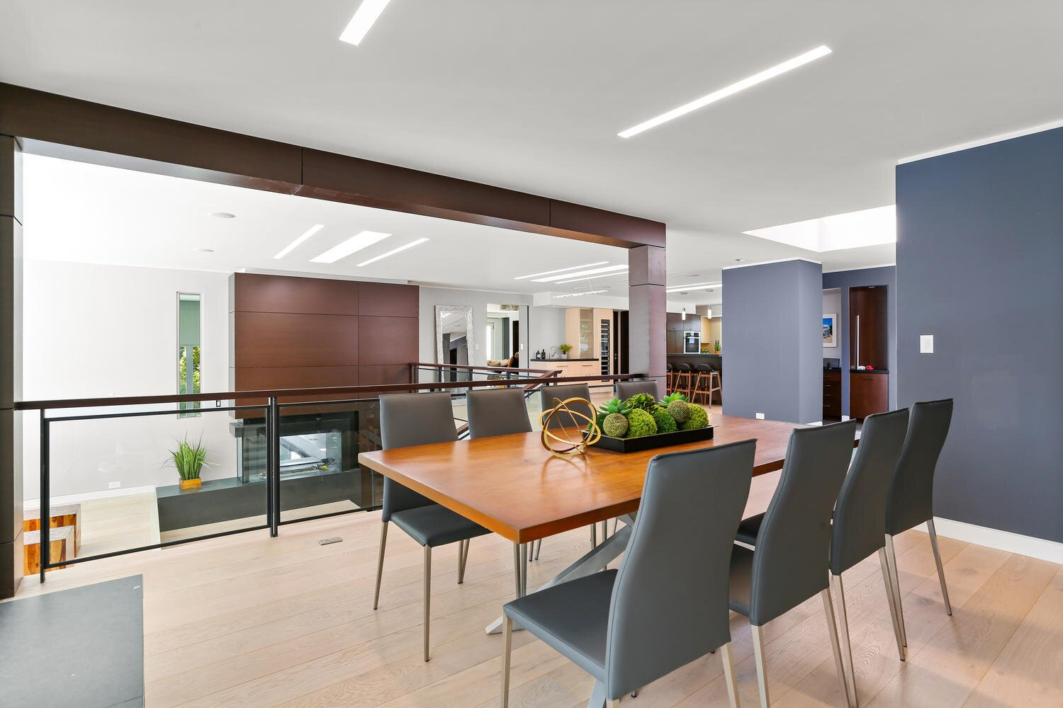Dining Room, Two-Sided Fireplace, Ceiling Lighting, Gas Burning Fireplace, and Recessed Lighting Dining Room overlooking leveled living area  A Gut Renovated MidCentury Modern Green Energy Home for Luxury Winter Living for $4.65m