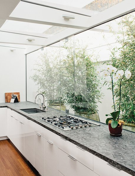 #kitchen #renovation #LosAngeles #courtyard #indoor #outdoor #white #open #light #skylight #orchid #bamboo  Photo 3 of 13 in 15 Flower Arrangements That Will Brighten Your Home on Valentine's Day from Batwing Kitchen Remodel